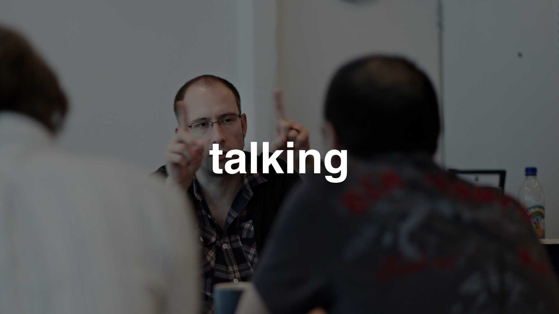 A photo of some people talking - text: talking