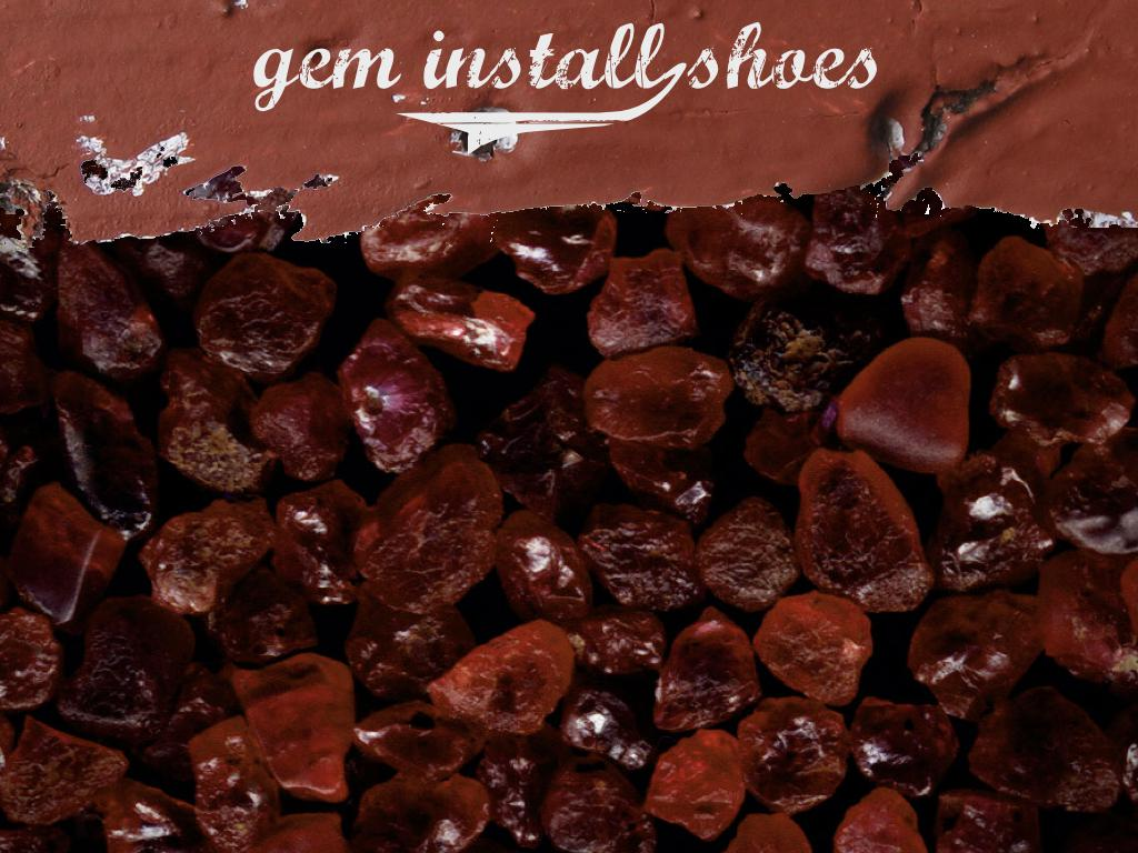 A photograph of many ruby gemstones. text: gem install shoes