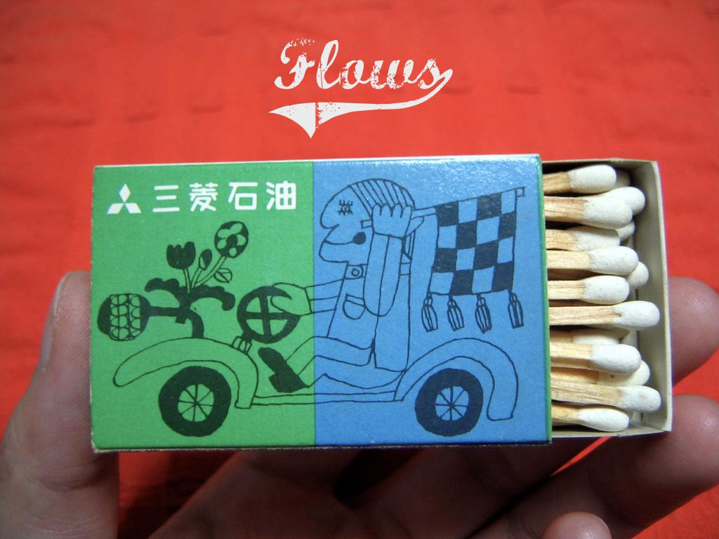 A photograph of a box of matches, partially open showing the layers of matches inside. text: Flows