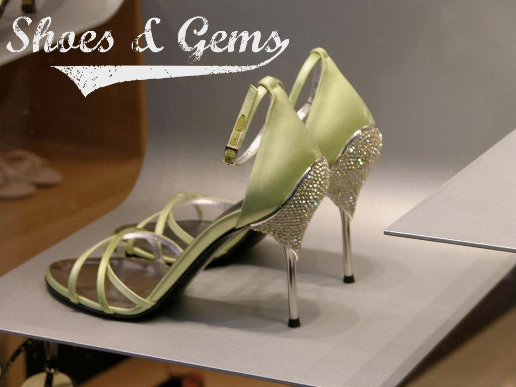 A photograph of a high-heeled shoe with gems embedded in the heel. text: Shoes & Gems