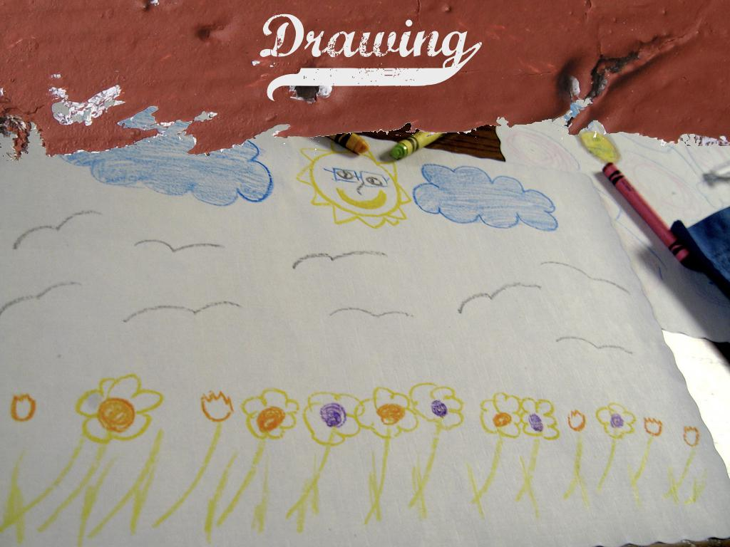 A photograph of a childs drawing of some flowers. text: Drawing
