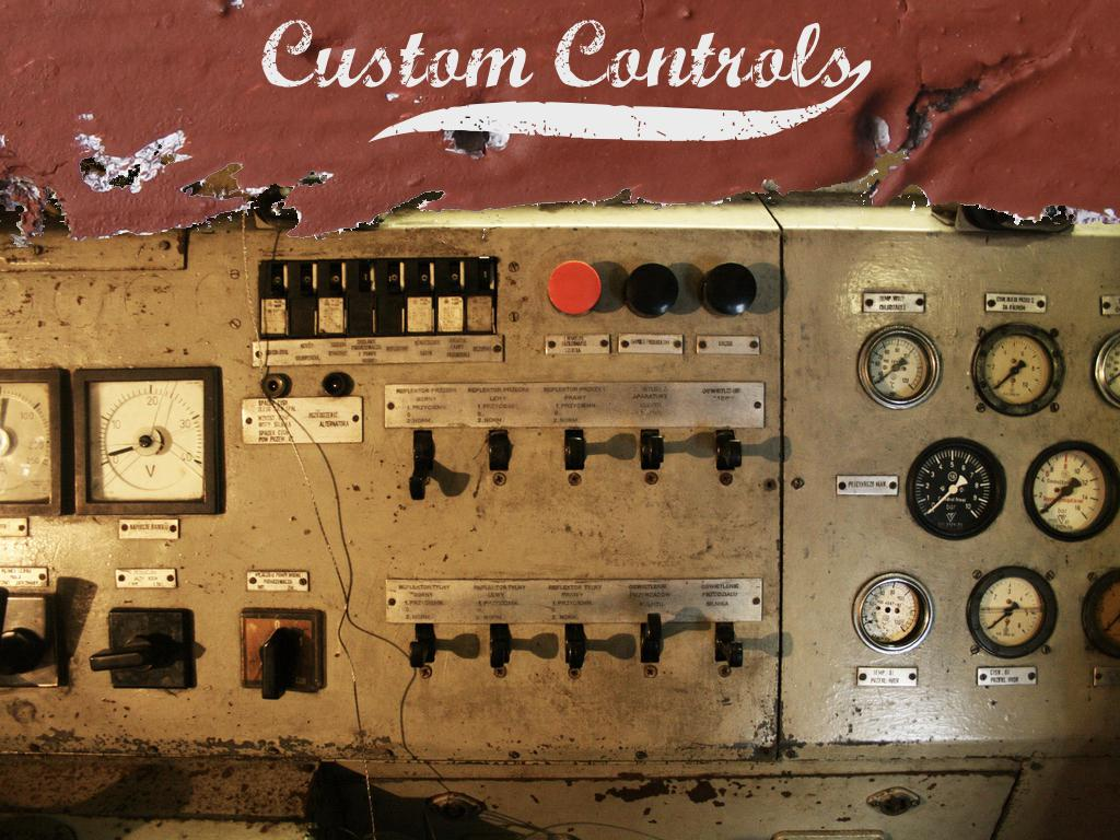 A photograph of a mechanical control panel with many dials, buttons, toggles, and switches. text: Custom controls